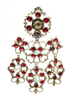 A late 18th century Iberian flat cut garnet and freshwater pearl pendant drop, later converted to a brooch, c.1800,