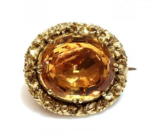 A William IV gold topaz brooch,
