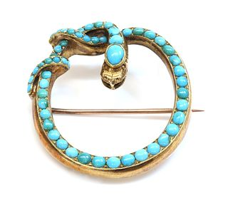 A Victorian gold turquoise set snake brooch/pendant,