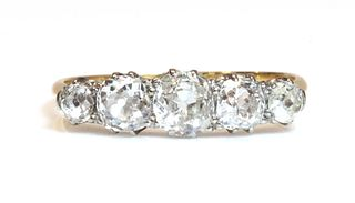 A five stone graduated diamond ring,