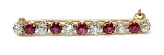 A ruby and diamond two colour bar brooch,