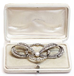 A cased former Austro-Hungarian diamond set bow and hoop brooch, by Ernest Paltsho, Vienna, c.1900,