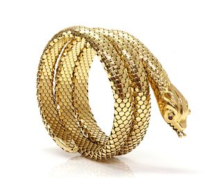 An Italian ruby set coiled snake style flexible bangle, c.1950,