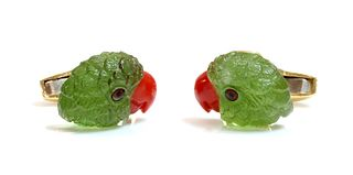 A pair of 18ct gold carved peridot and coral parrot head cufflinks, by Deakin & Francis, retailed by Hamilton & Inches, c.2010,