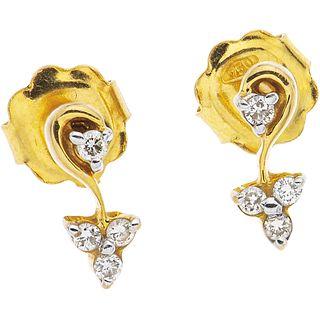 PAR DE BROQUELES CON DIAMANTES EN ORO AMARILLO DE 18K   PAIR OF STUD EARRINGS WITH DIAMONDS IN 18K YELLOW GOLD