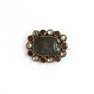 A Georgian gold and silver, garnet and paste memorial brooch,
