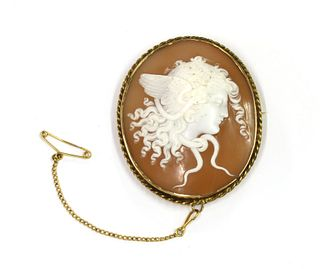 A gold mounted shell cameo brooch,