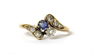 An Edwardian gold sapphire and diamond crossover ring,
