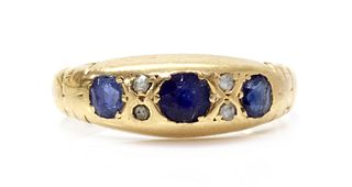 An Edwardian 18ct gold sapphire and diamond ring,