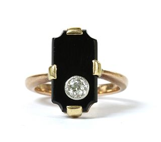 A gold diamond and onyx ring,