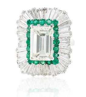 A 5.03 CT EMERALD CUT DIAMOND RING IN A BALLERINA SETTING