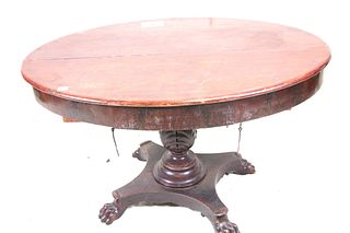 ANTIQUE MAHOGANY OVAL CENTER TABLE ON PAW FEET