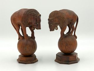 Pair of Carved Rosewood Lions on Spheres