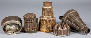Five tin food molds, 19th c.