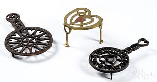 Three iron and brass trivets