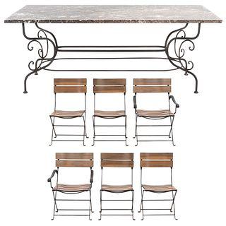Comedor. SXX. Elaborado en herrería. Mesa con cubierta de mármol y soportes semicurvos. 4 sillas y 2 sillones. 75 x 200 x 110 cm (mesa)