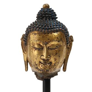 A GILT BRONZE BUDDHA HEAD