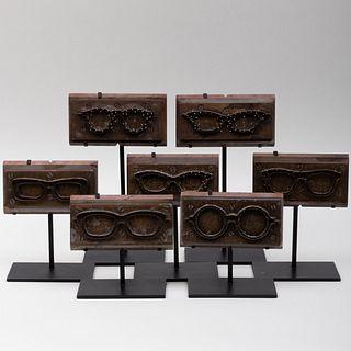 Group of Seven Metal Eye-Glass Molds