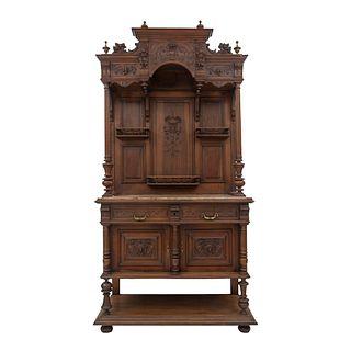 APARADOR. FRANCIA, SXX. Estilo ENRIQUE II. Elaborado en madera de nogal. Con 2 cajones con tiradores de metal, 2 puertas