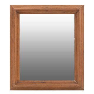 Espejo. SXX. Elaborado en madera. Con luna rectangular. Decorado con molduras.