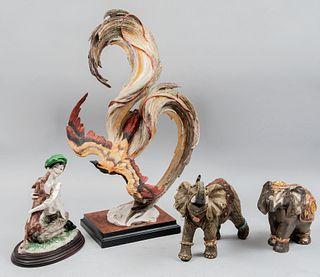 Lote de 4 figuras decorativas. Italia y otros orígenes, sXX. Elaborados en resina policromada. Fénix firmado y seriado. 47 cm alt mayor