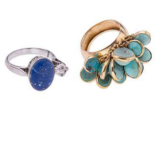 Dos anillo con turquesas en oro amarillo de 16k y plata paladio. Tallas: 5. Peso: 12.1 g.