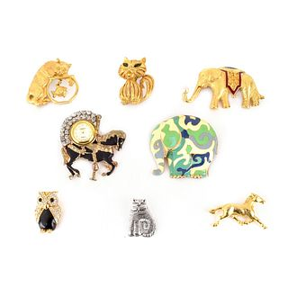 Eight Costume Brooches