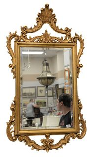 Chippendale style mirror with gold frame, height 54 inches, width 30 inches.