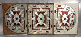 """Set of Three Stained Glass Windows to include, a pair along with an arch shaped window, 37"""" x 43 1/2"""" and 35"""" x 43""""."""