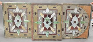 """Set of Three Stained Glass Windows, to include a pair along with an arch shaped window, 37"""" x 43 1/2"""" and 35"""" x 43""""."""