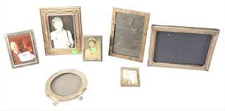 "Seven Sterling Silver Frames. largest 8 1/2"" x 6 1/2""."