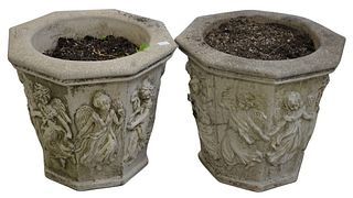 Pair of Nina Studio Outdoor Planters, each in octagonal form, having raised angle decorations, height 19 1/2 inches, diameter 22 inches.