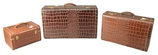 Set of Three Alligator Skin Travel Suitcases, height 15 inches, largest width 26 inches.