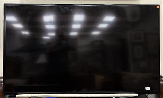 """Samsung 60"""" Flat Screen Television, along with a Samsung Blu-Ray player."""
