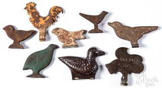 Eight cast iron shooting targets, ca. 1900