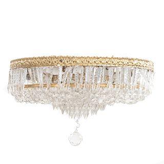 Lámpara de techo. SXX. Diseño circular. Elaborada en metal dorado. Con cuentas de cristal facetado.