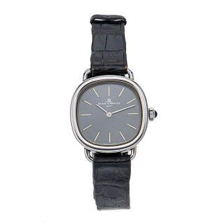 Reloj Baume & Mercier. Movimiento manual. Caja circular en acero de 24 mm. Carátula color gris con índices de barras.