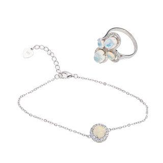 Pulsera, pendiente y anillo con ópalos en plata .925. 5 cabujones de ópalos. Talla: 6 1/2. Peso: 7.2 g.