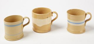 Three Yellow Ware Mugs