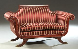 Duncan Phyfe Style Carved Mahogany Settee, 20th c., the canted back with an arched crest rail, to large rolled arms, over a removable seat cushion, on