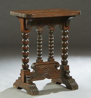 Continental Bobbin Turned Oak Side Table, late 19th c., the rounded edge rectangular top on bobbin turned trestle legs,with lappet carved splayed feet
