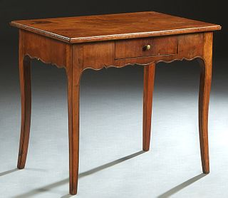 French Provincial Louis XV Style Carved Walnut Side Table, 19th c., the ogee edge rectangular top over a scalloped skirt with a central frieze drawer,