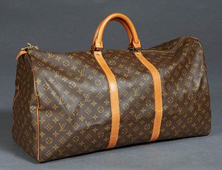Louis Vuitton Keepall 60 Travel Bag, in a monogram coated canvas, with vachetta leather accents and golden brass hardware, opening to a brown canvas l