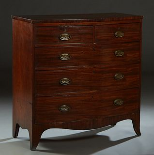 English Carved Mahogany Georgian Style Bowfront Chest, 19th c., the bowed top over two frieze drawers above three deep drawers, on splayed legs joined