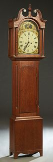 English Carved Oak Tallcase Clock, 19th c., the broken arch top with a central turned finial over an arched glazed door enclosing a hand painted arche