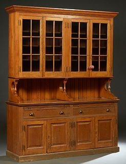 Large Carved Cypress Hutch, 20th c., New Orleans, the ogee crown over two pair of mullioned glazed doors, on turned tapered supports to a base with tw