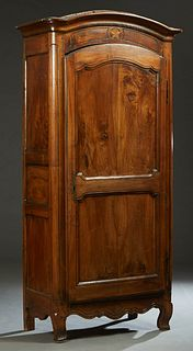 French Provincial Louis XV Style Carved Walnut Armoire, 19th c., the stepped arched rounded corner crown over an arched double panel door with an iron