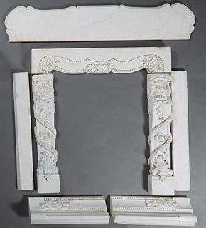 Carved White Marble Fireplace Mantel, late 19th c., the ogee edge serpentine top above a thick serpentine skirt, flanked by floral and garland carved