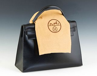 Hermes Kelly Sellier Handbag, c. 1987, in natural black box calf leather with gold hardware, opening to a matching leather lined interior, stamped Q i