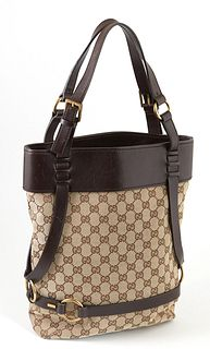Gucci Brown Supreme Canvas Vintage Vertical Tote Shoulder Bag, the dark vachetta leather straps with brushed gold hardware, opening to a brown interio
